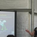 Dr. Maria de la Fuente uses a smart phone app and portable speaker to deliver the Spanish presentation.